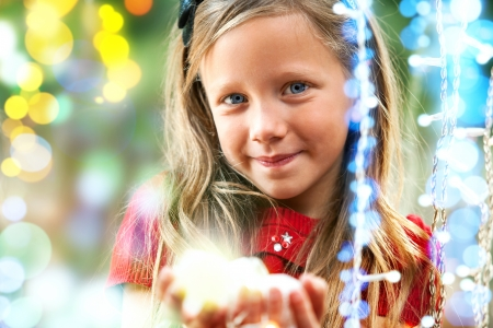 expectations: Close up portrait of cute girl among colorful blurry lights