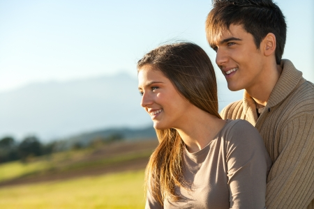 Close up portrait of young couple in sunny countryside. Stock Photo - 16985401