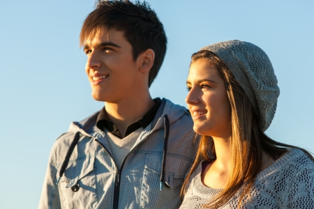 Close up portrait of handsome teen couple looking in the distance outdoors. Stock Photo - 16985400