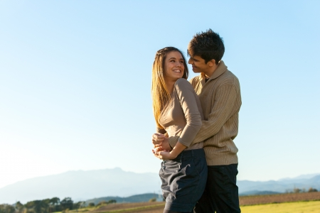 In love teen couple showing affection outdoors. Stock Photo - 16971372