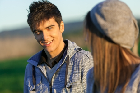 Portrait of handsome boy with girlfriend in countryside. Stock Photo - 16971389