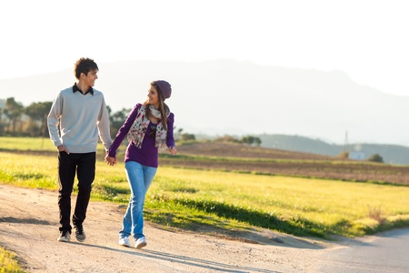 Young couple having a walk on dirt road in countryside Stock Photo - 17244812