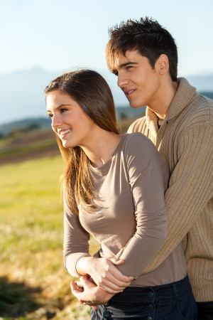 countryside loving: Portrait of young handsome couple outdoors in rural field.