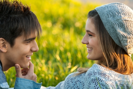 Close up portrait of young couple outdoors with in love face expression. Stock Photo - 17244814