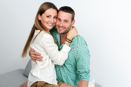 Close up portrait of attractive couple hugging indoors. Stock Photo - 17286299