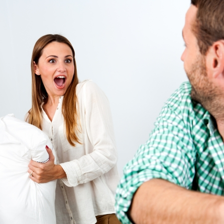 Couple having fun with pillow fight indoors. Stock Photo - 17239226