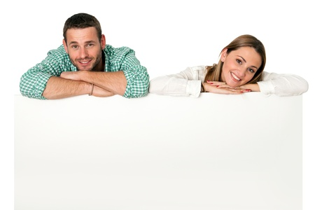 Close up portrait of young couple resting on white blank board with copy space.Isolated on white. Stock Photo - 17239276