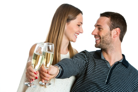 champagne toast: Close up portrait of cute couple making a toast with sparkling wine. Isolated on white. Stock Photo