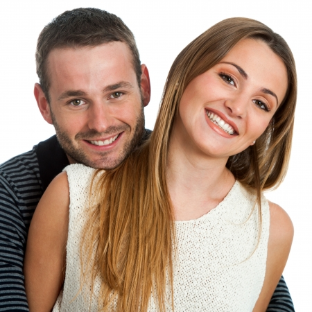 Close up portrait of handsome young smiling couple.Isolated on white. Stock Photo - 17238284