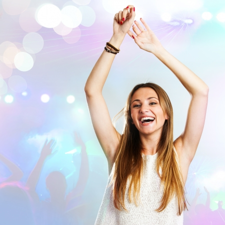 young attractive woman dancing to the beat with disco background. Stock Photo - 17238299