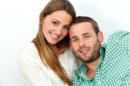 Close up portrait of handsome couple with heads together. Isolated on white. photo