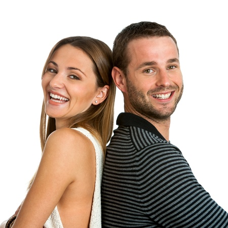 Close up portrait of smiling couple back to back.Isolated on white. photo