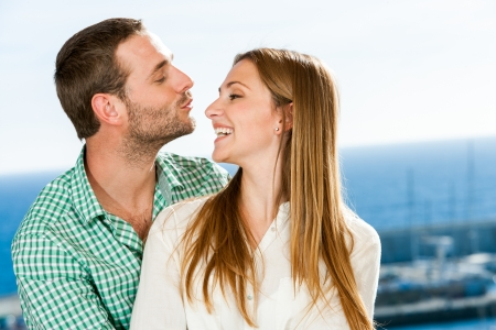 Close up portrait of young couple playing around outdoors. Stock Photo - 17238280