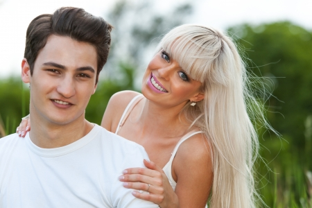 Close up portrait of attractive young couple in park.  photo