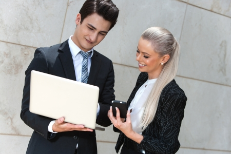 Portrait of young business couple reviewing information. photo
