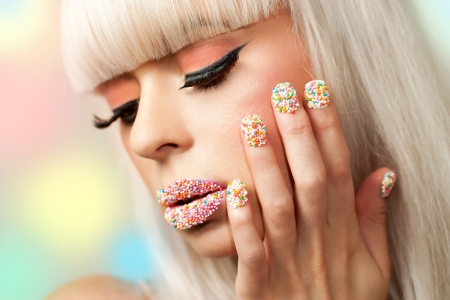 finger on lips: Extreme close up beauty portrait of girl with sugar sprinkle dot make up. Stock Photo