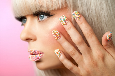 Extreme close up of fantasy make up with sugar sprinkle dots. photo