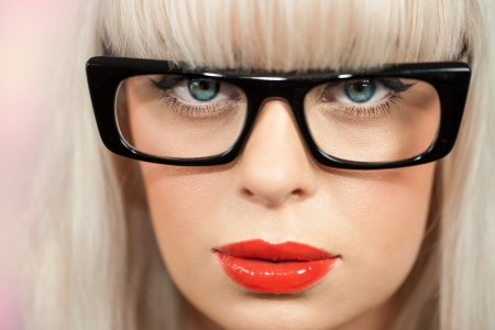 extreme close up of woman with retro black plastic glasses. photo
