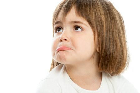 downhearted: Portrait of small unhappy girl with funny face expression.Isolated. Stock Photo
