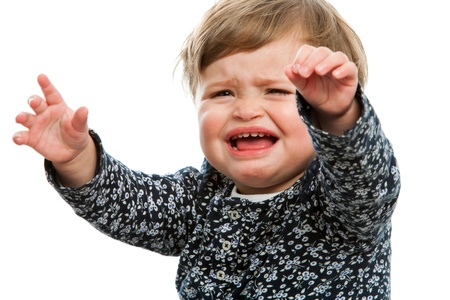 downhearted: Close up portrait of unhappy toddler crying for attention. Stock Photo