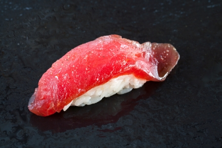nigiri: Extreme close up of fatty tuna belly nigiri sushi.