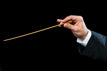 Close up of male conductors hand directing.