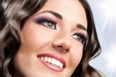 extreme macro: Close up face shot of beauty brunette smiling.  Stock Photo
