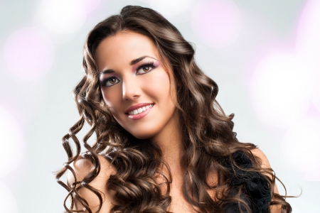 Beauty portrait of Stunning brunette with curly hairstyle. Stock Photo - 19386469