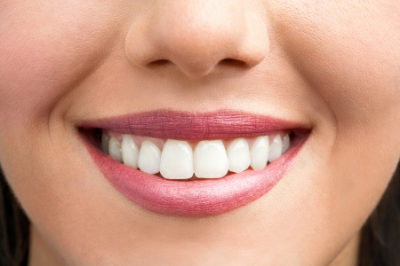 a tooth are beautiful: Macro close up of female smile showing healhy white teeth.