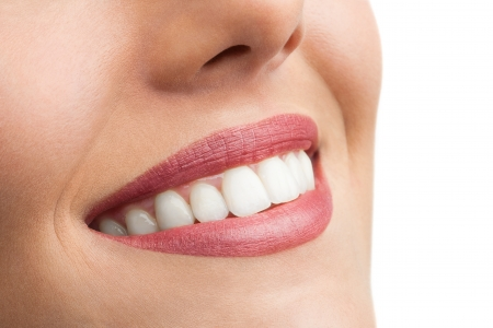 Macro close up of perfect female teeth isolated on white. Stock Photo