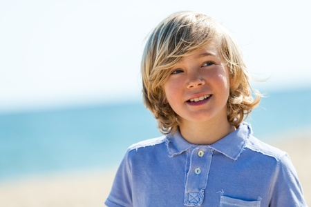 preteens beach: Close up portrait of handsome boy looking aside outdoors.