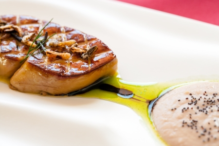foie gras: Macro close up of grilled foie gras with sweet honey dressing.