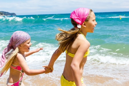 Young girls having fun together at sea  photo