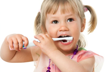 tooth paste: Close up portrait of little girl brushing teeth.Isolated on white background.