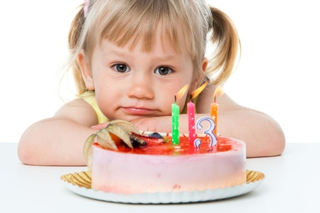 strawberry cake: Close up portrait of cute girl with birthday cake.Isolated on white.