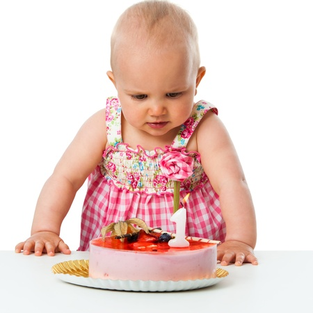 children party: Portrait of cute baby girl celebrating first birthday with cake.Isolated on white. Stock Photo