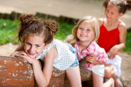 threesome: Three Kids having fun together in playground. Stock Photo