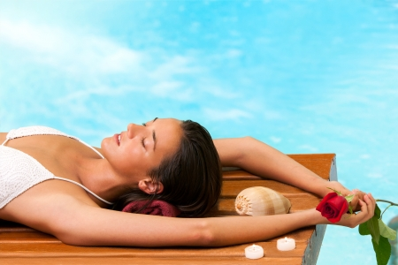 day spa: Portrait of attractive woman relaxing next to pool in spa.