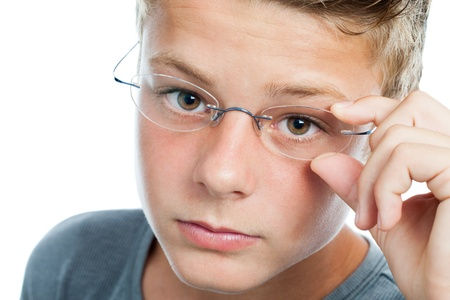 myopic: Macro face portrait of cute teen with myopic eye wear.Isolated on white.