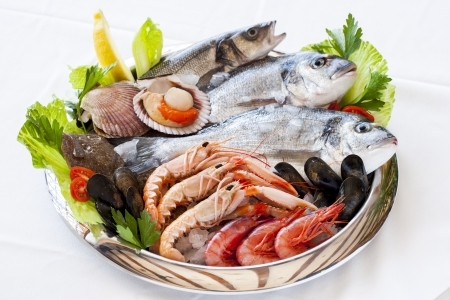 seafood platter: Close up of fresh mediterranean seafood on ice. Stock Photo