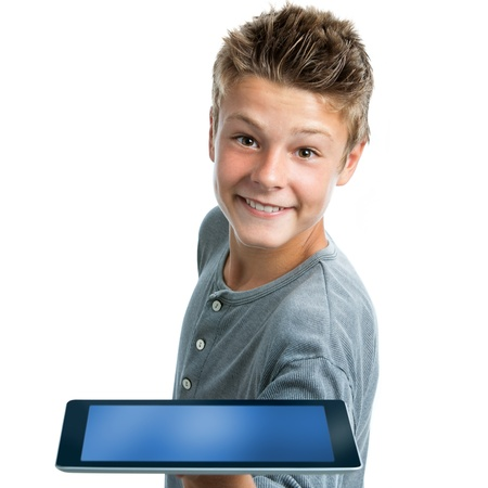 Close up portrait of cute teen boy showing blank tablet.Isolated on white background. photo