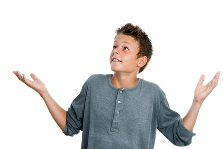 cute teen boy: Portrait of surprised teen boy with arms open. Isolated on white background. Stock Photo