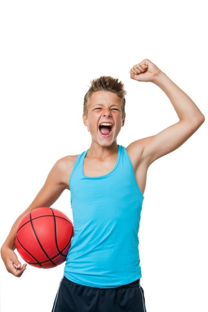 Portrait of teen basketball player with winning attitude.isolated on white. photo