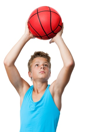 boy basketball: Portrait of teen sportsman catching a basketball.isolated on white. Stock Photo