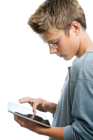 Close up portrait of teen boy working on tablet.Isolated on white background. photo