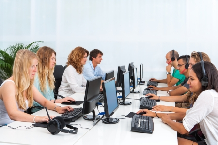 computer training: Group of young students doing training course on computers. Stock Photo