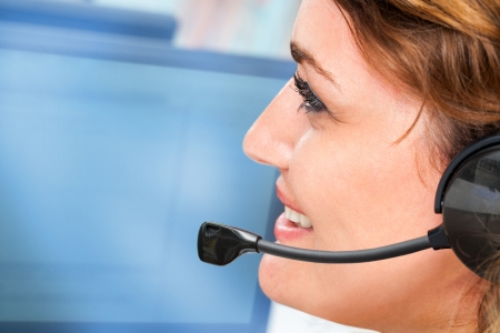 tele up: Extreme close up portrait of female with headset giving customer service. Stock Photo
