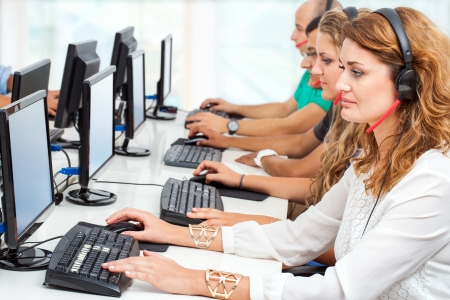 developers: Group of young business students working together in classroom. Stock Photo