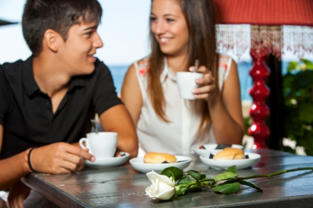 Young couple drinking coffee on romantic anniversary date.  photo