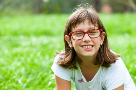 Portrait of friendly handicapped girl outdoors. photo